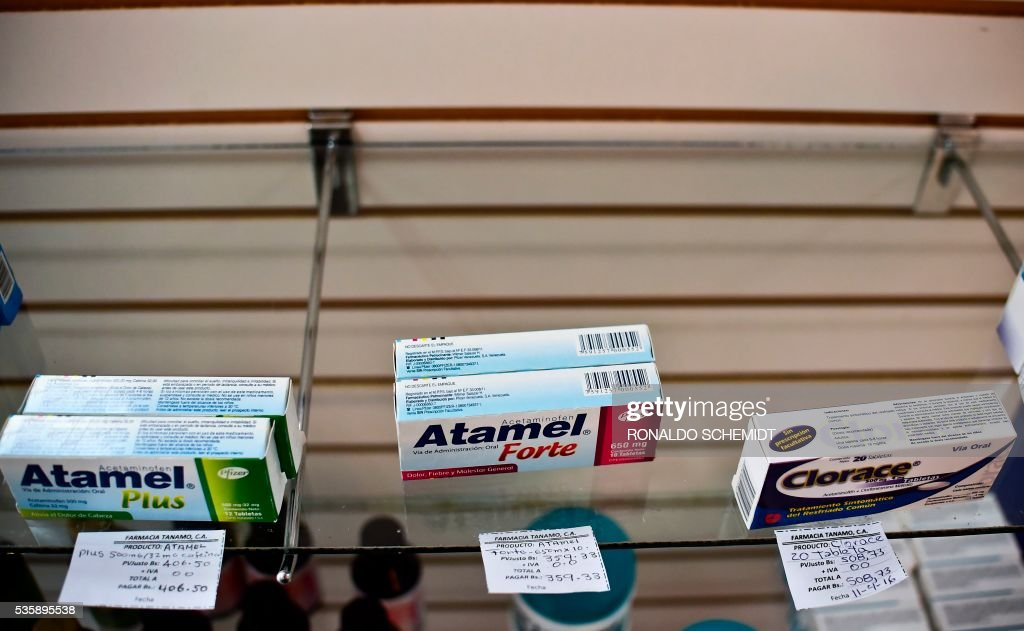 Medicines are depicted in a pharmacy in Caracas on May 30, 2016. The shortage of medicines in Venezuela exceeds 85%, revealed the president of the harmaceutical federation of Venezuela, Freddy Ceballos. / AFP / RONALDO