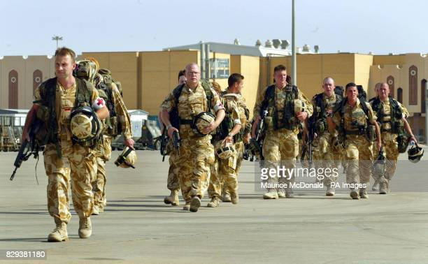 Medics accompany soldiers from the Black Watch along the airport runway to board a Hercules C130 at Basra International Airport The Black Watch...