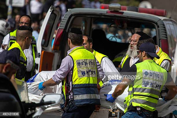 Medics attend the scene of a stabbing attack on October 13 2015 in Jerusalem Israel Tensions in the area continue to run high following multiple...