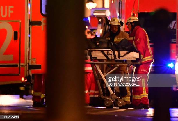 TOPSHOT Medics attend to an injured person after a truck crashed into a christmas market at Gedächtniskirche church in Berlin on December 19 2016...