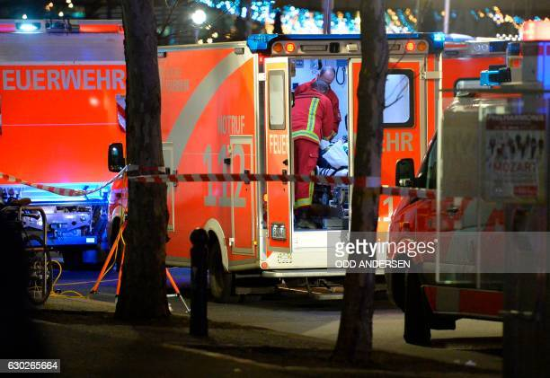 Medics attend to an injured person in an ambulance after a truck crashed into a christmas market at Gedächtniskirche church in Berlin on December 19...