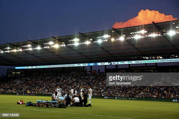 Medics attend to Minnesota United defender Joseph Greenspan after an injury while storm clouds loom over the stadium in the second half of a US Open...