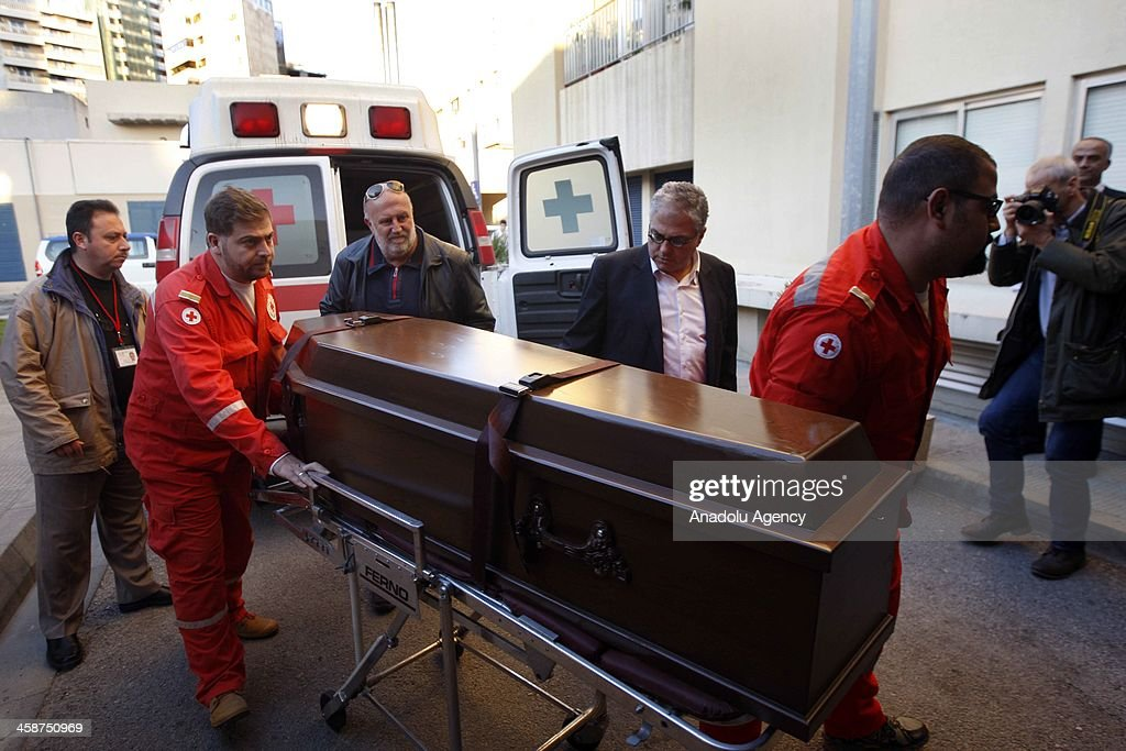 Medics carry the coffin during the arival of the body of the Indian-origin British doctor Abbas Khan, who died in Syrian prison, at Hotel Dieu de France Hospital in capital Beirut, Lebanon on December 21, 2013. Doctor Abbas Khan's body was received by his family.