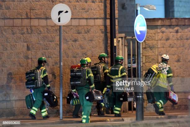 Medics deploy at the scene of a reported explosion during a concert in Manchester England on May 23 2017 British police said early May 23 there were...