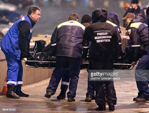 Medics lift the body of Russian opposition leader Boris Nemtsov covered with plastic on Moskvoretsky bridge near St Basil cathedral in central Moscow...