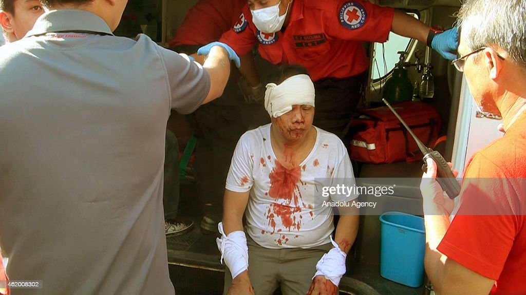 Medics treat an injured man at the scene of a bomb blast outside a bus station in Zamboanga City on Janaury 23 2015 A powerful explosion rocked the...