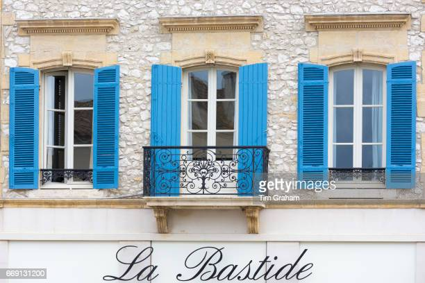 Medieval architecture wrought iron balcony shutters La Bastide Restaurant in 13th Century bastide town Eymet Aquitaine France