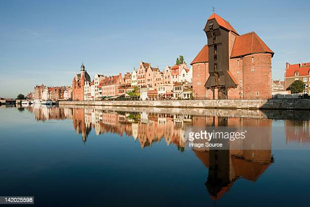 Medieval buildings reflected in water, Gdansk, Poland