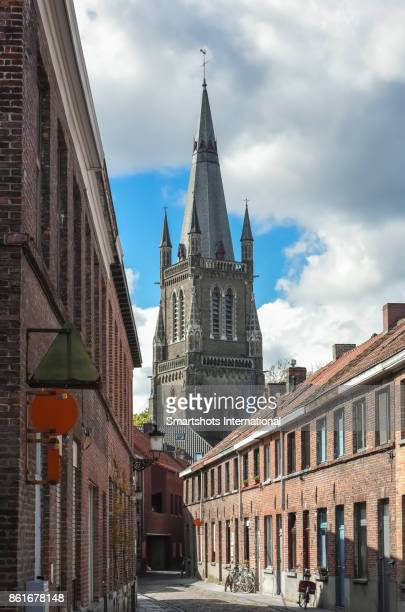 Medieval church spire seen from unusual position in Bruges, Belgium