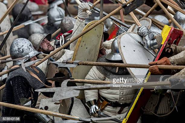 Medieval enthusiasts take part in the reenactment of a medieval battle in the Czech Republic on April 23 2016 in Libusin Czech Republic About 2000...