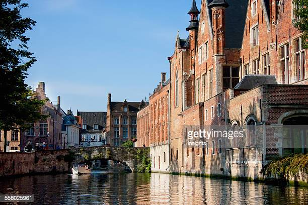 Medieval houses along a canal Bruges West Flanders Belgium