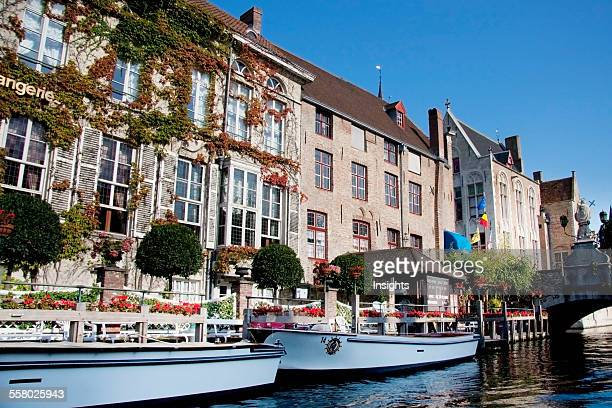 Medieval houses reflected in a canal Bruges West Flanders Belgium