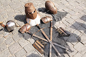 Medieval knight's armor, helmets, chain mail, swords, on a paving stones