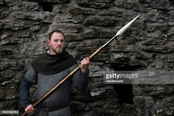 Medieval man holding pointed weapon