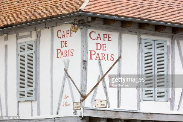 Medieval old architecture and shutters of Cafe de Paris Bar Restaurant in 13th Century bastide town Eymet on September 19 2015 in Aquitaine France