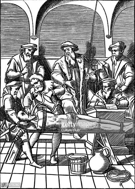 Medieval torture scene French water torture the man has nine pints of water poured down his throat Woodcut from 'Praxis Criminis Persequendi' 1556