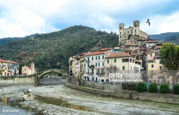 Medieval townscape of Dolceacqua with roman bridge, riverbank and 'Doria' castle in Liguria, Italian Riviera, Italy
