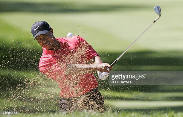 Tiger Woods of the US hits out of the sand trap on the ninth hole 20 August 2006 during the 88th PGA golf championship at the Medinah Country Club in...