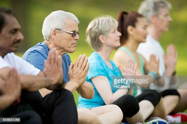 Meditating During an Outdoor Yoga Class
