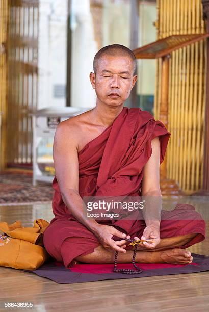 A meditating monk at the Shwedagon Pagoda in Yangon in Myanmar