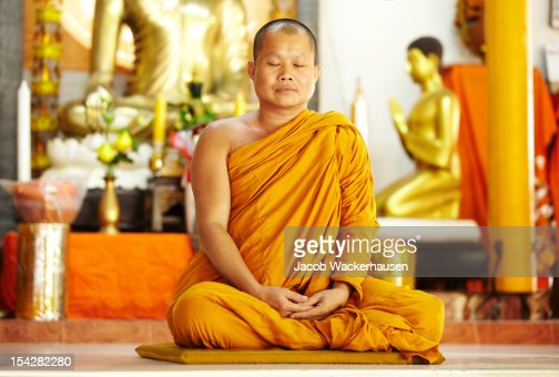 Meditating monk in a sacred shrine : Stock Photo