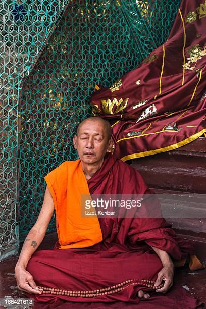 Meditating monk in the Shwedagon Pagoda