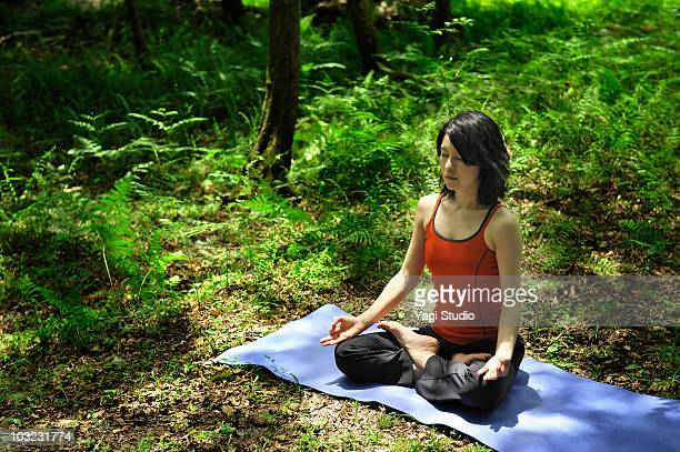 Meditating woman in the nature
