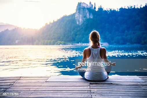 Meditation by the lake : Stock Photo