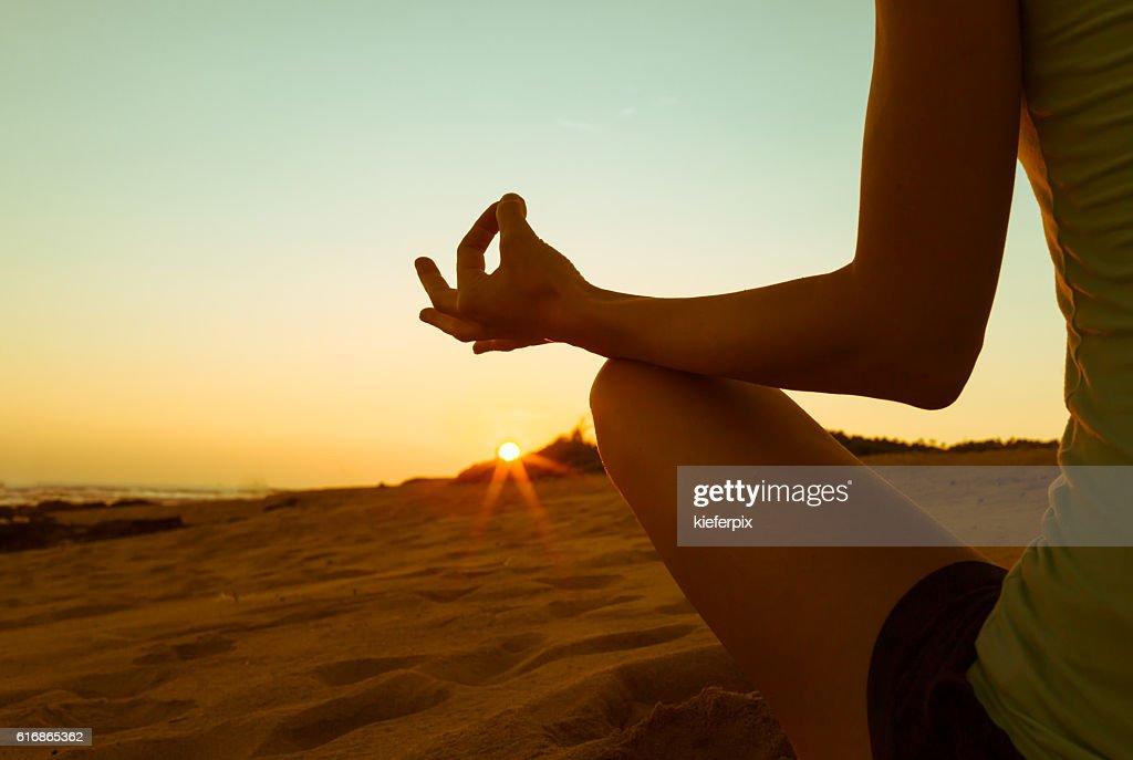 Meditation on the beach : Stock Photo