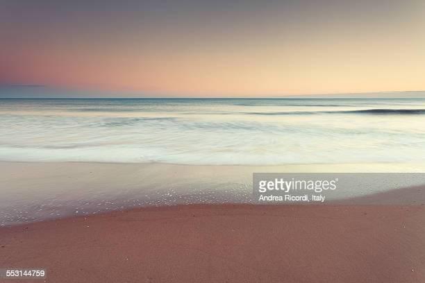 Mediterranean beach at sunset