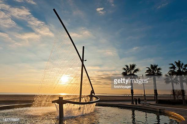 Mediterranean beach fountain sunrise Valencia Spain