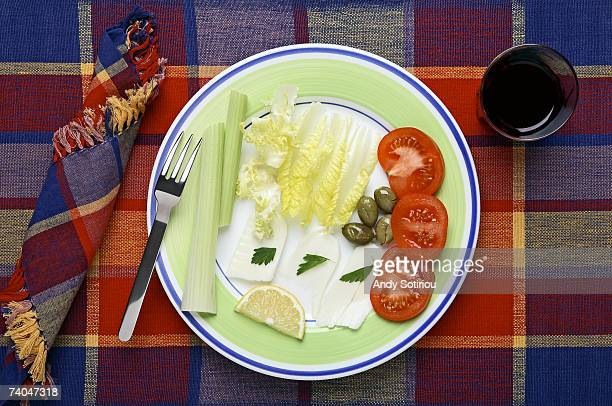 Mediterranean light meal of celery, olives, Halloumi cheese and tomatoes, overhead view