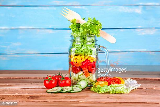 Mediterranean salad in a mason jar with handle