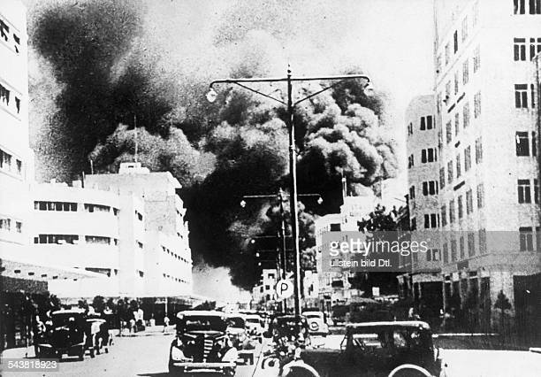 2WW Mediterranean Theatre of war air warBombing of the british oil deposits at Haifa by the italian avaiaton burning oil raffinerie