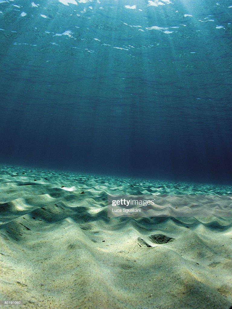 Mediterranean water, sand and sunburst