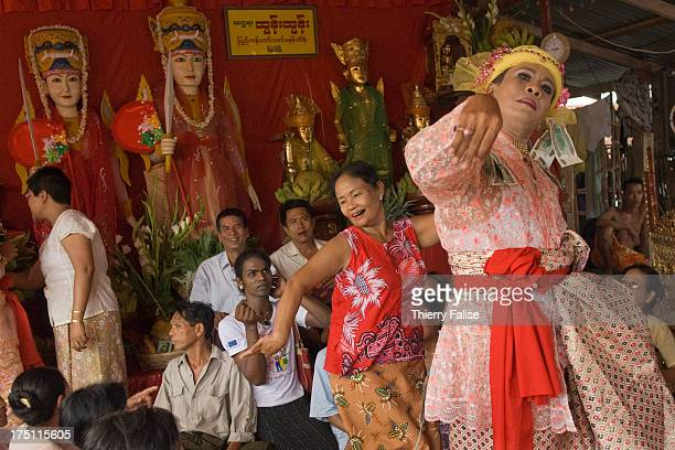 A medium dances in one of the numerous shrines dedicated to the nats during the Taungbyon festival Every year in August hundreds of thousands of...