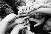 Medium  group of people , close-up of hands
