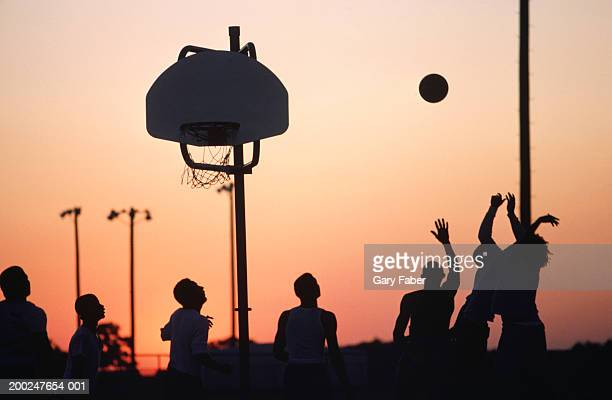 Medium group of people playing basketball, Louisiana, USA