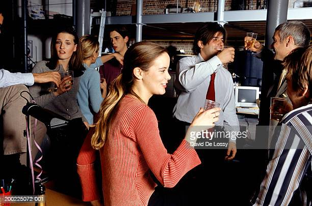 Medium group of people proposing toast at office party