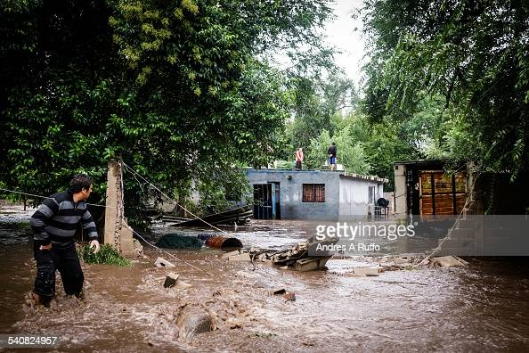 A medium group people losing their homes after the flooding of the river caused floods in the city of Mendiolanza province of Cordoba Argentina on...