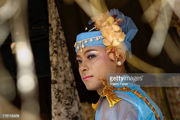 A medium in a ceremonial dress before a dance at Taungbyon festival Every year in August hundreds of thousands of people from all over Myanmar gather...