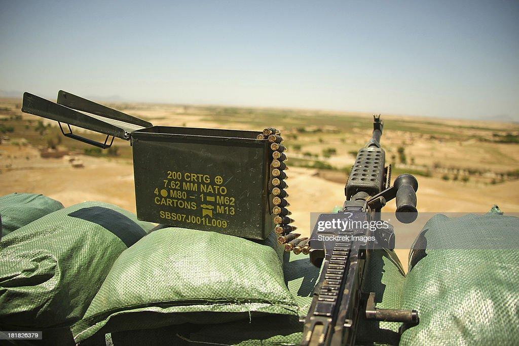 A M240B medium machine gun is positioned at an observation post.