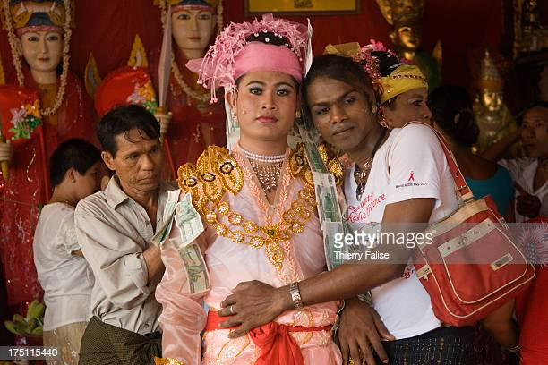 A medium pauses with a companion after a dance during the Taungbyon nat festival Every year in August hundreds of thousands of people from all over...