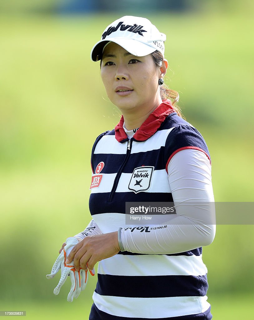 <a gi-track='captionPersonalityLinkClicked' href=/galleries/search?phrase=Meena+Lee&family=editorial&specificpeople=787206 ng-click='$event.stopPropagation()'>Meena Lee</a> of South Korea reacts to her birdie on the ninth green during round two of the Manulife Financial LPGA Classic at the Grey Silo Golf Course on July 12, 2013 in Waterloo, Canada.