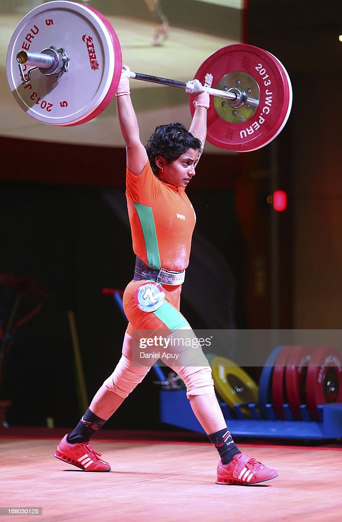 Meera Parshram Fakade of India B competes in the Women's 48kg during day one of the 2013 Junior Weightlifting World Championship at Maria Angola Convention Center on April 04, 2013 in Lima, Peru.