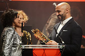 Meera Syal and MyAnna Buring present the award for Best Director to Yann Demange for '71' at the Moet British Independent Film Awards 2014 at Old...