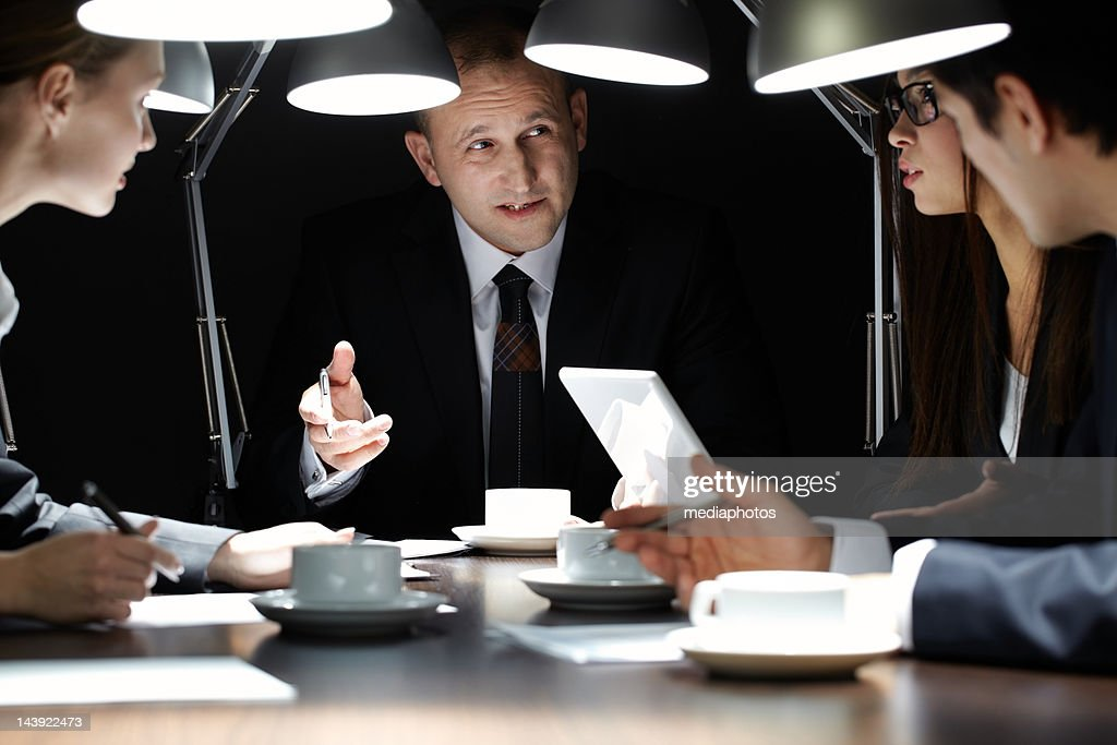 Meeting at the end of day : Stock Photo