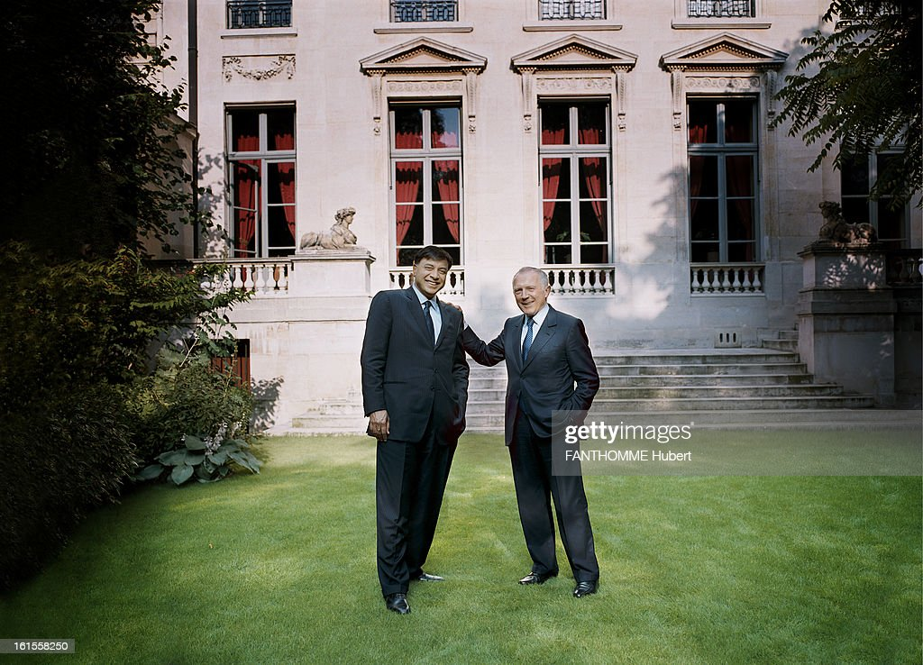 Meeting Francois Pinault Lakshmi Mittal Francois Pinault attitude smiling in the garden of his mansion PARIS one hand resting on the shoulder of...
