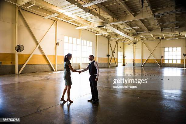 Meeting in Empty Office Warehouse