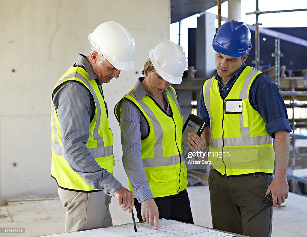 Meeting of professionals on a building site : Stock Photo